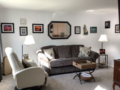 Living room with leather recliner,  comfy sofa,  tv and local cable programming