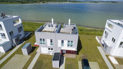 Photo for Modern Beach House located directly on the Schlei - dreamlike view of the water - close to the idyllic Schleiufer - private spa area - three terraces - first class facilities