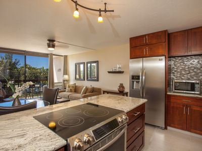 Photo for The nicest condo in the complex w/ocean views.  Across the street from the beach