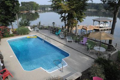 View of the pool, dock and lake.