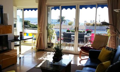 Photo for Modern light filled apartment with terrace & parking, near beach and shops,