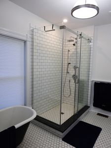 En-suite with a cast iron tub and separate shower.