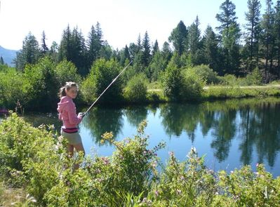 Wild roses line our PRIVATE stocked fishing pond --- everybody catches dinner