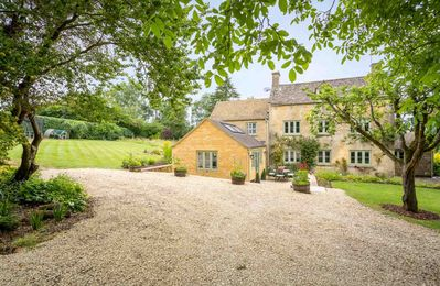 Photo for Laurel Tree Cottage is an exquisite family home in the picturesque village of Guiting Power