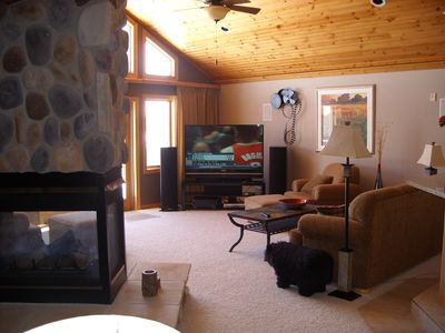 Great Room / 3 Sided Fireplace / 65' Flat Screen