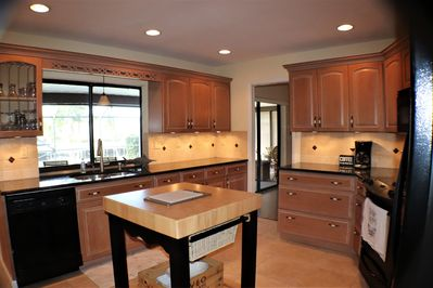 Brand new , heart of the house kitchen with pass thru window to lanai