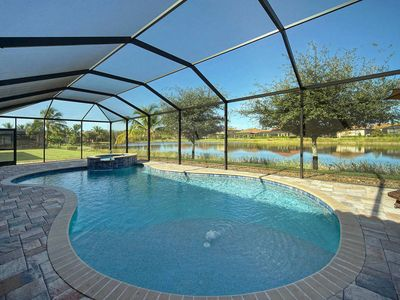 Photo for **Soak up the Sun by the Heated Pool Overlooking the Sparkling Lake**