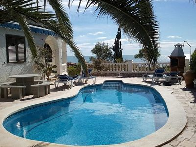 Photo for Cottage on the beach - incredible view of the sea - private pool
