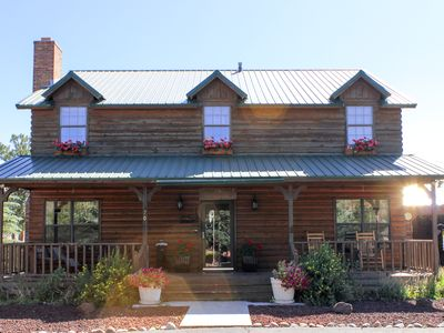 Photo for NEW LISTING! Classic log lodge w/shaded porch, patio & chiminea - near hiking