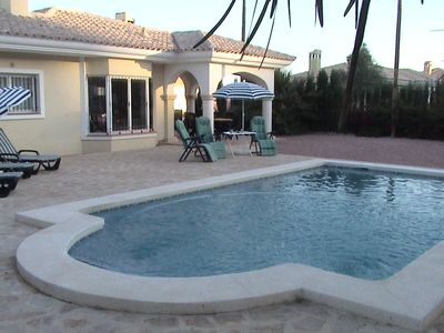 Private pool with sunterrace and garden furniture, bbq, parasols & diningtable.