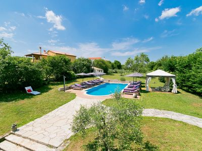 Photo for This 7-bedroom villa for up to 16 guests is located in Pula and has a private swimming pool, air-con