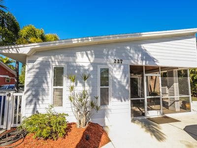 Welcome to Island Time!  This is a  3 bedroom, 2 full bath, one level, canal front home with a large, fenced, outdoor lanai space and heated pool!