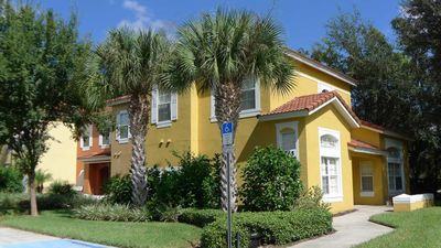 Photo for Uniquely elegant Emerald Island 4/3.5 Townhome. Prestigious resort community ten minutes to Disney!