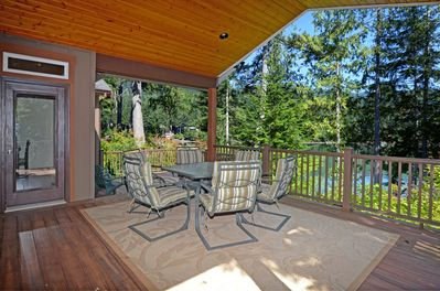 Lovely outdoor covered deck area for dining and watching nature.