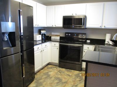 Photo for Couples Come Stay and Play! Direct Beach Front. Walk to Pier Park
