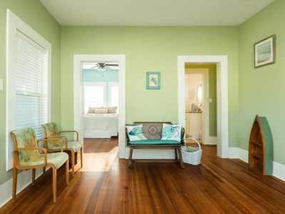 Photo for Colorful dog-friendly bungalow w/ covered back patio, two blocks from beach