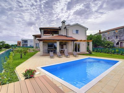 Photo for Exclusive villa with private pool, 3 bedrooms, 3 bathrooms, air conditioning, WiFi, balcony, terrace, parking and private barbecue area