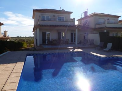 Photo for 4 bed villa overlooking golf course, 12 minutes from beach