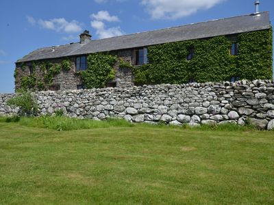 Photo for A mile from the sea at Dyffryn Ardudwy, Hayloft is a quality barn conversion, situated on an organic