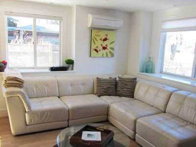 Photo for West end  condo. Sleeps 6.  Short walk to town or beach. 2 car parking Pets ok