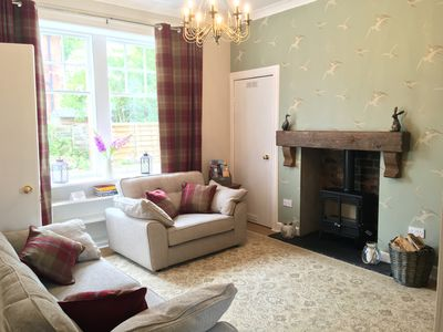Sunny south facing living room with wood burning stove