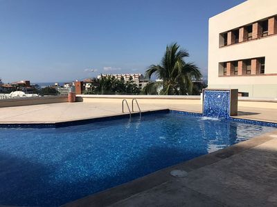 Photo for Condo with an amazing view, short distance walk to the heart of town and beach.