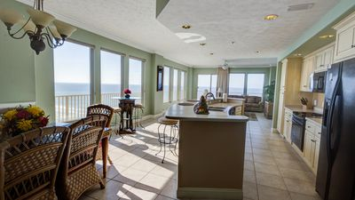 Open concept living room, kitchen and dining room with expansive Gulf views