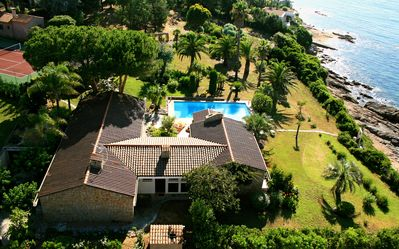 Photo for Beachfront villa with private tennis court and heated pool on 4400 m2