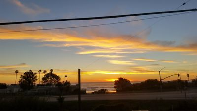 Photo for Coastal VIEWS with easy SURF ACCESS.   Home with yard and spa...pets considered!