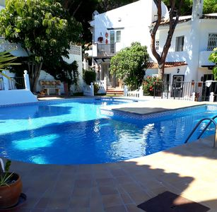 Photo for Charming townhouse with pool and close to beach