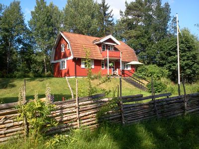Photo for Beautiful red Sweden house in the woods with lake but also your location