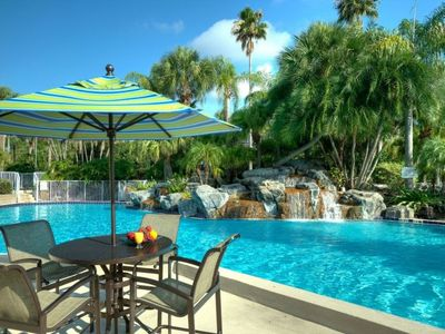 Photo for CLOSE TO ATTRACTIONS! PERFECT UNIT FOR 4! POOL, HOT TUB, PARKING, SHUTTLE