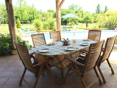 Photo for Extremely spacious, Country Farmhouse with pool & summer kitchen, sleeps 13+