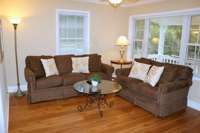 Comfortable furniture and bright windows make this a perfect place to relax.