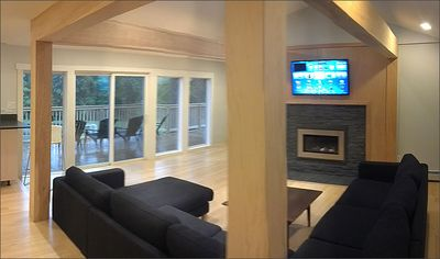 Living room with tv, wifi, gas fireplace and deck.