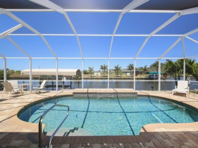Photo for Florida Sunshine Awaits! Newly Furnished Waterfront Pool Home - Dock - Beaches