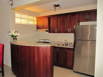 Stainless stell appliances, rich mahoghany woodwork