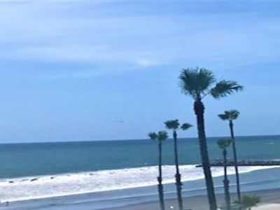 Photo for Oceanview of waves, shore, beach, surfers, sunset from all balconies and windows