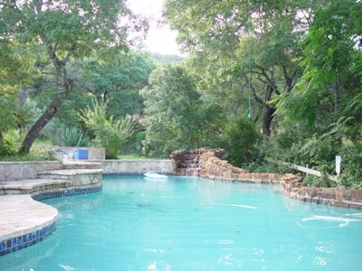 Large Private Pool with Waterfall. Seating all around and built into a ravine