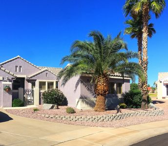 Casita sits behind palm trees,parking in front W/ street lighting in cul-de-sac