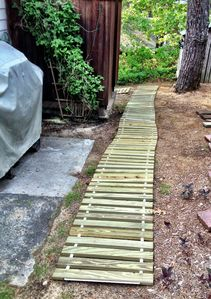 Boardwalk pathway to outside shower & down to W/D in cellar.