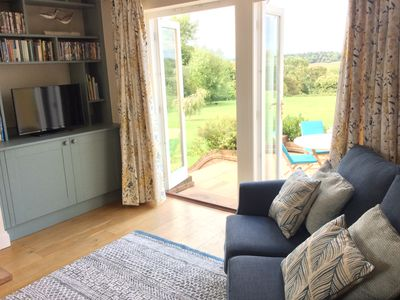 Photo for Riverside retreat over looking the stunning Waveney Valley - fishing & kayaking