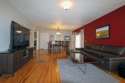 """Living Room w/ leather couch, 58"""" Plasma TV w/ HD, dining table w/ seating for 8"""