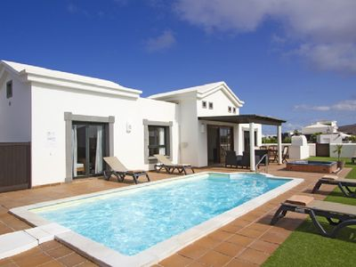 Photo for Luxury private villa - heated pool and hot tub.