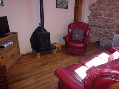 Cosy lounge area with woodburning stove
