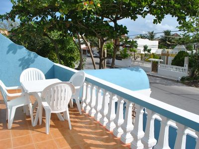 Photo for Bright, airy apartment, private balcony close to beach, 4 blks to town sqyare