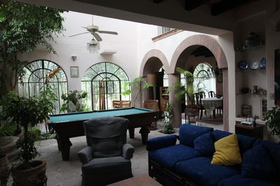 View of Pool Table in Solarium From Den