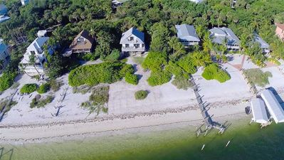 Photo for NORTH CAPTIVA BAYFRONT COTTAGE WATCH BEAUTIFUL SUNRISES AND SOME DOLPHINS PLAYING