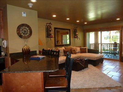 Completely remodeled with travertine flooring; new furniture, granite.