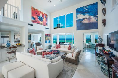 Relax within the living room with designer accents, high ceilings, and spectacular views.